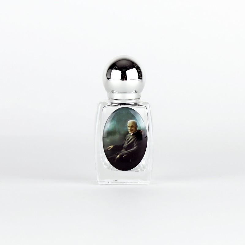 Bouteille pour eau bénite en verre , saint frère André